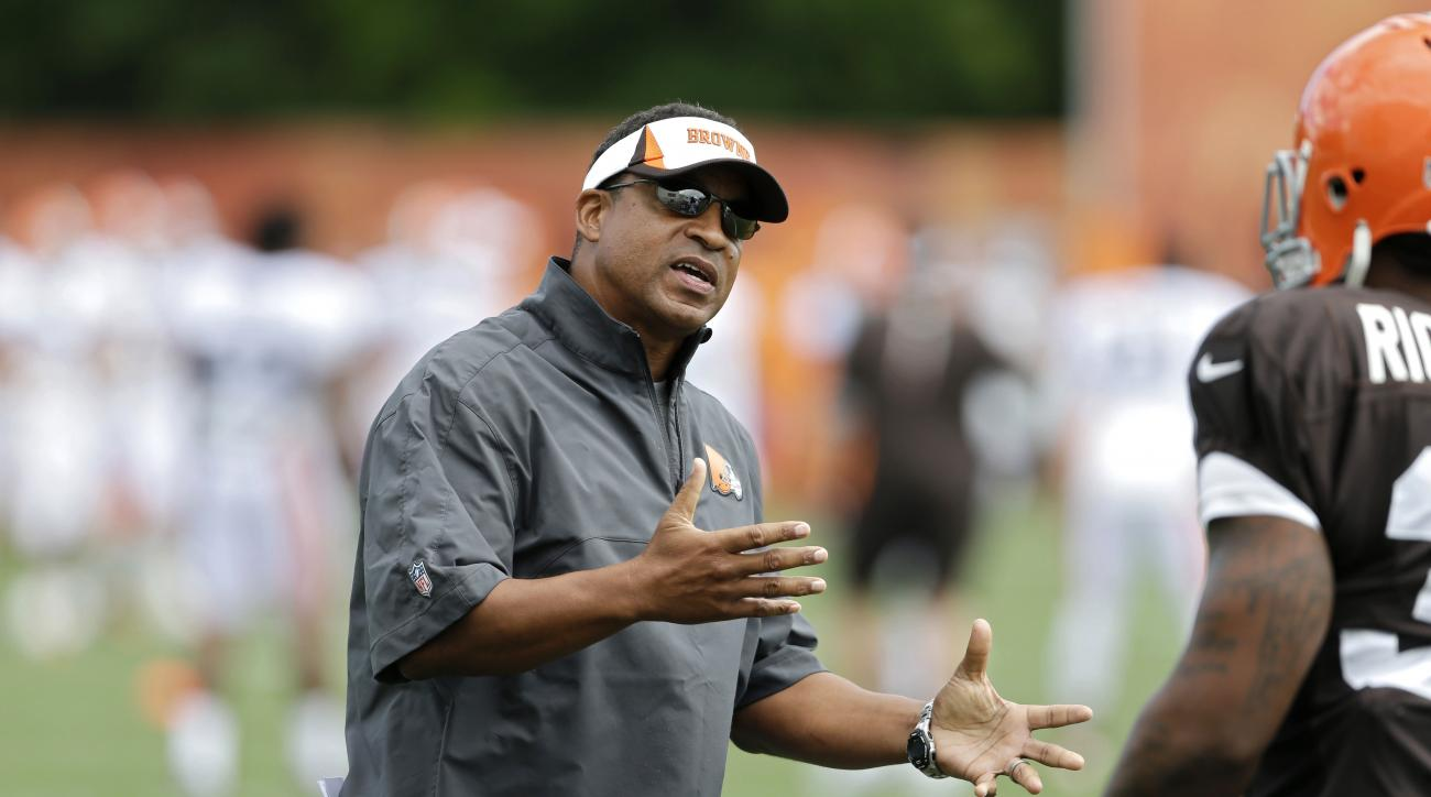 FILE - In this Sunday, July 28, 2013 file photo, Cleveland Browns defensive coordinator Ray Horton gestures during training camp at the NFL football team's facility in Berea, Ohio. A person familiar with the hiring says new Browns coach Hue Jackson has ad