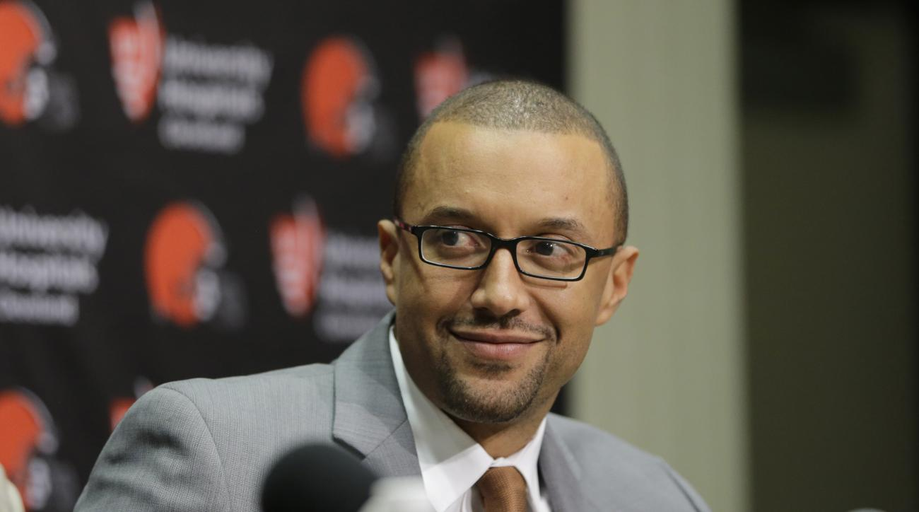 FILE - In this Jan. 13, 2016, file photo, Executive Vice President of Football Operations Sashi Brown addresses the media during a news conference in Berea, Ohio. The Browns are not in any rush to make a decision on quarterback Johnny Manziel's future. Sa