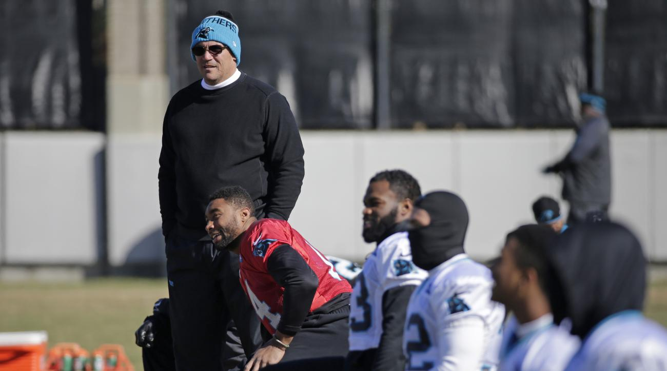 Carolina Panthers head coach Ron Rivera, top, watches his team during the NFL football team's practice in advance of the NFC Championship game against the Arizona Cardinals in Charlotte, N.C., Thursday, Jan. 21, 2016. (AP Photo/Chuck Burton)