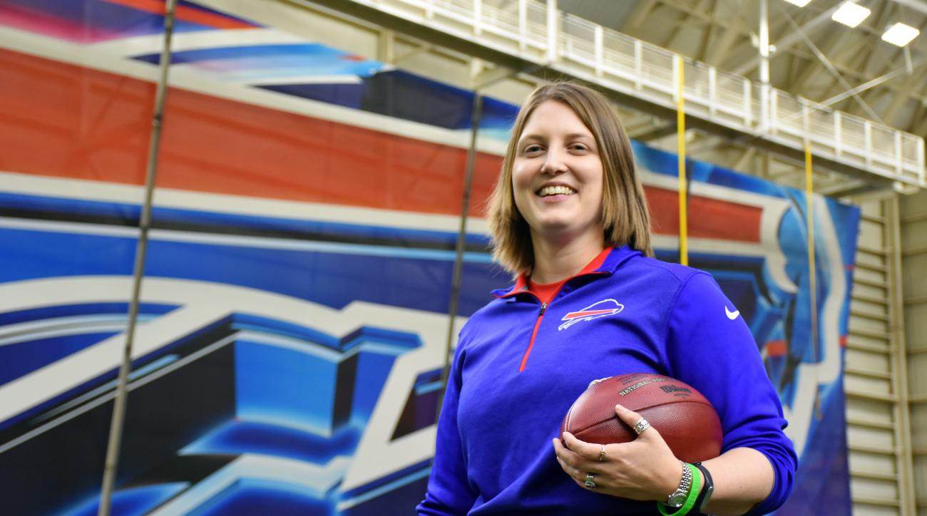 In this photo provided by the Buffalo Bills, Bills assistant football coach Kathryn Smith poses, Thursday, Jan. 21, 2016, in Orchard Park, N.Y. Smith is the first, full time, female assistant coach in the National Football League. (Anna Stolzenberg/Buffal