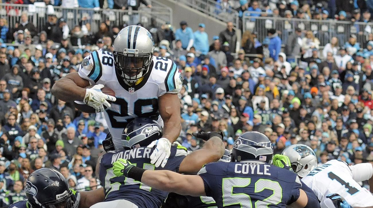 FILE - In this Sunday, Jan. 17, 2016, file photo, Carolina Panthers running back Jonathan Stewart (28) leaps over the Seattle Seahawks defensive line to score a touchdown during the first half of an NFL divisional playoff football game in Charlotte, N.C.