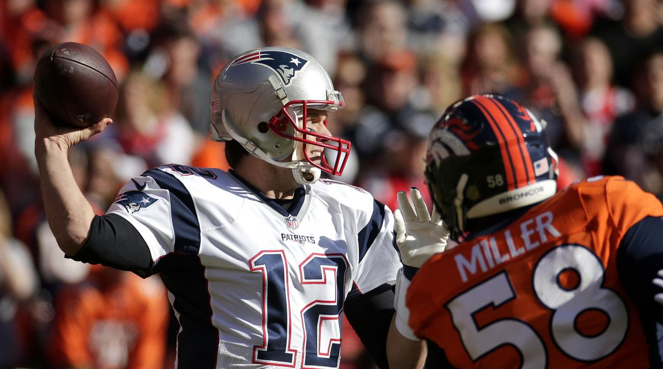 New England Patriots quarterback Tom Brady (12) reaches back to throw while being defended by Denver Broncos outside linebacker Von Miller during the first half the NFL football AFC Championship game between the Denver Broncos and the New England Patriots