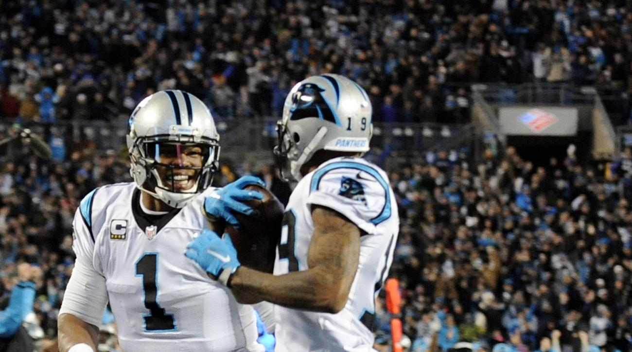 Carolina Panthers' Ted Ginn runs for a touchdown as teammate Cam Newton runs with him during the first half the NFL football NFC Championship game against the Arizona Cardinals Sunday, Jan. 24, 2016, in Charlotte, N.C. (AP Photo/Mike McCarn)