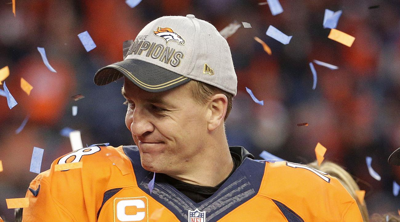 Denver Broncos quarterback Peyton Manning holds the AFC Championship trophy following the NFL football AFC Championship game between the Denver Broncos and the New England Patriots, Sunday, Jan. 24, 2016, in Denver. The Broncos defeated the Patriots 20-18
