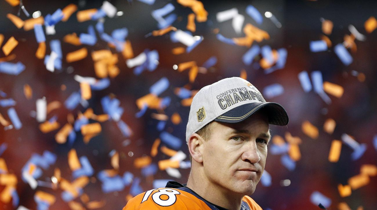 Denver Broncos quarterback Peyton Manning watches the AFC championship trophy presentation following the NFL football AFC Championship game between the Denver Broncos and the New England Patriots, Sunday, Jan. 24, 2016, in Denver. The Broncos defeated the