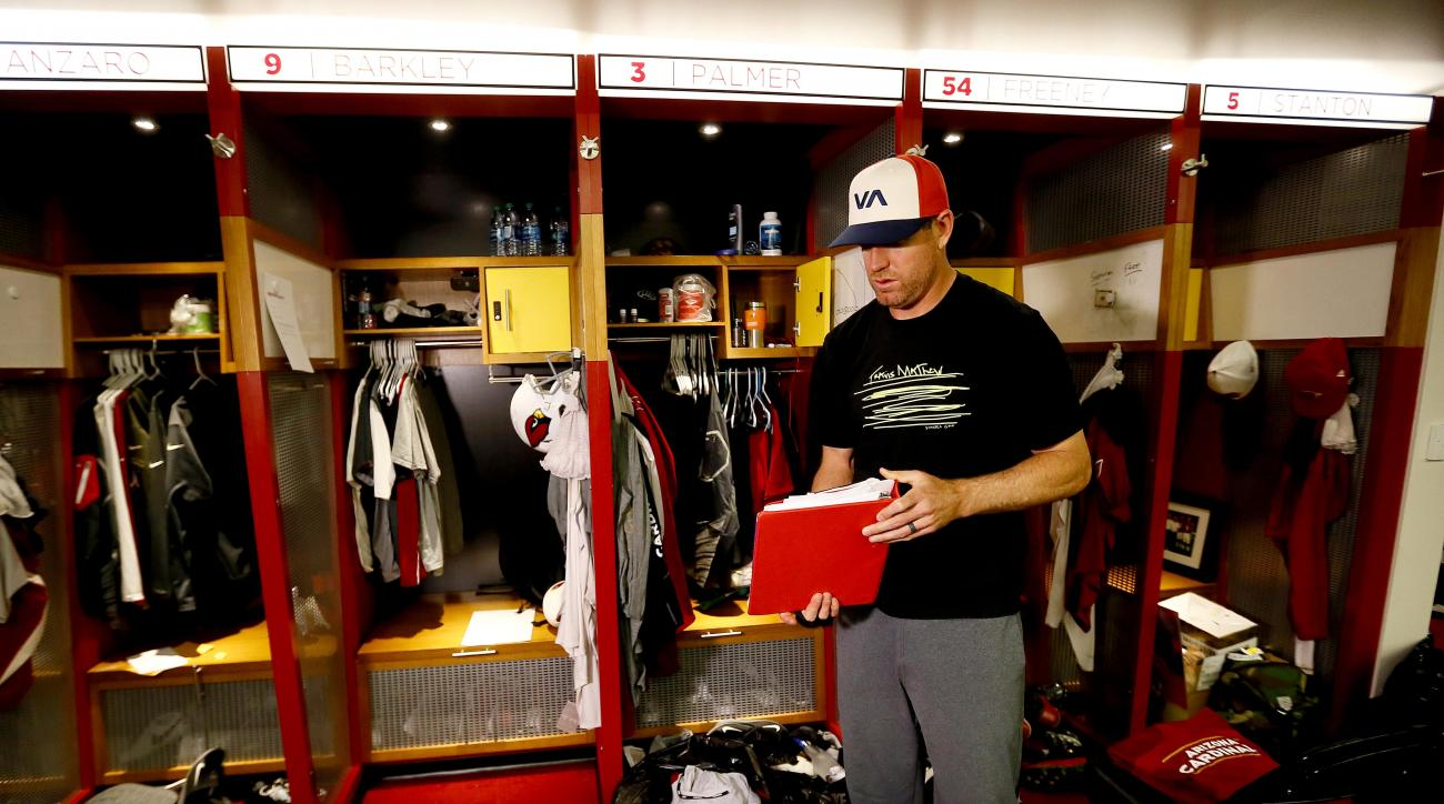 Arizona Cardinals quarterback Carson Palmer cleans out his locker, Monday, Jan. 25, 2016, in Tempe, Ariz. The Cardinals lost to the Carolina Panthers in the NFC Championship football game to end their season. (AP Photo/Matt York)