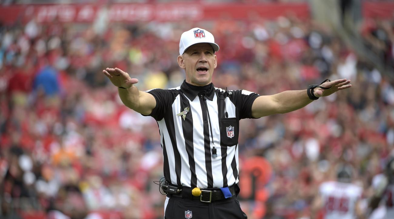 FILE - In this Sunday, Nov. 9, 2014 file photo, official Clete Blakeman calls a penalty during the first half of an NFL football game between the Tampa Bay Buccaneers and Atlanta Falcons in Tampa, Fla. The NFL announced Wednesday, Jan. 27, 2016 that eight