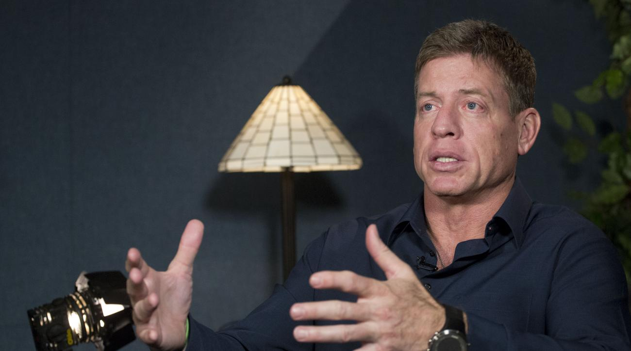 Former Dallas Cowboys quarterback Troy Aikman talks during an interview with The Associated Press, Wednesday, Jan. 27, 2016, in New York. If Cam Newton has the type of Super Bowl debut Aikman did, the Carolina Panthers will be in good shape for the Super