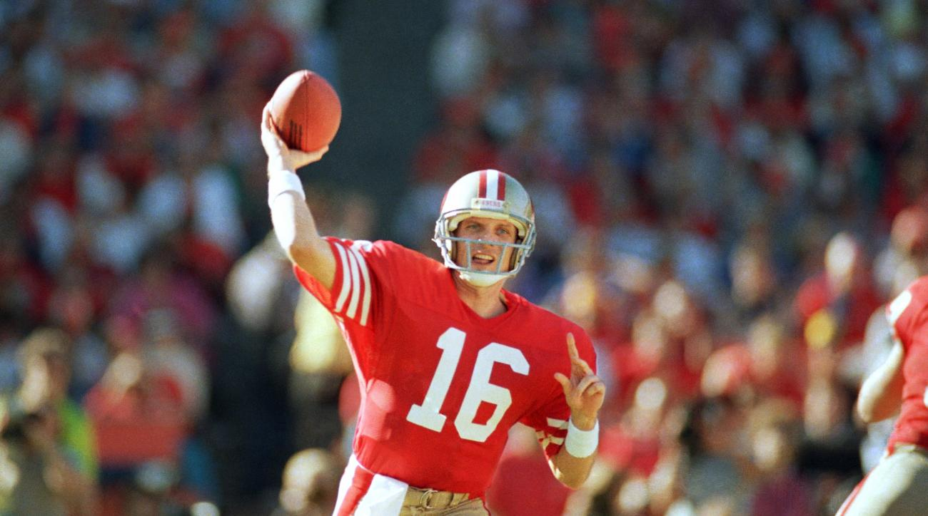 FILE - In this Sunday, Nov. 9, 1986, file photo, San Francisco 49ers quarterback Joe Montana passes during the first quarter against the St. Louis Cardinals at Candlestick Park in San Francisco. Montana was selected to the Super Bowl 50 Golden Team, Thurs