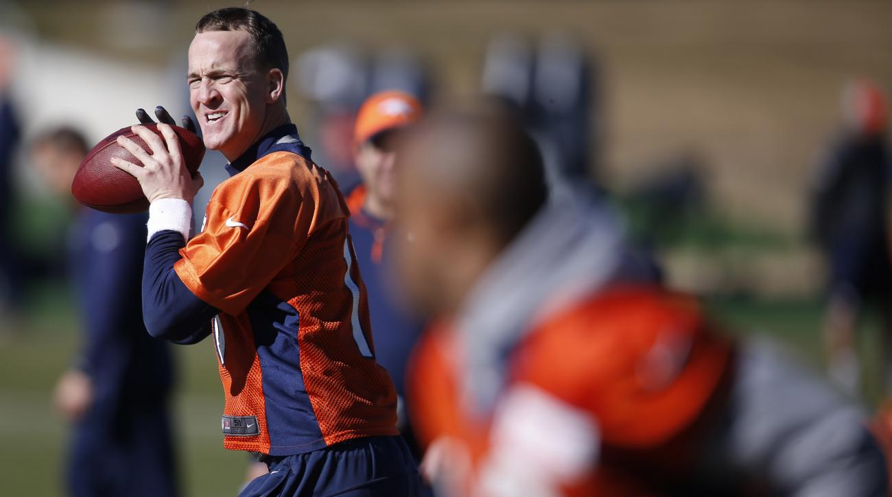 Denver Broncos quarterback Peyton Manning, back, looks to throw to wide receiver Andre Caldwell, front, during an NFL football practice at the team's headquarters Thursday, Jan. 28, 2016, in Englewood, Colo. The Broncos are preparing to face the Carolina