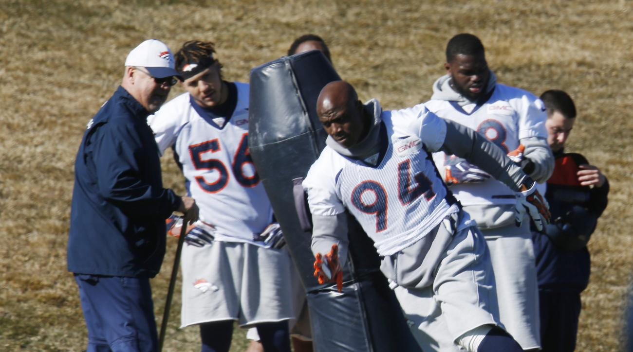 Denver Broncos outside linebacker DeMarcus Ware takes part in a drill during an NFL football practice at the team's headquarters Thursday, Jan. 28, 2016, in Englewood, Colo. The Broncos are preparing to face the Carolina Panthers in the Super Bowl next Su