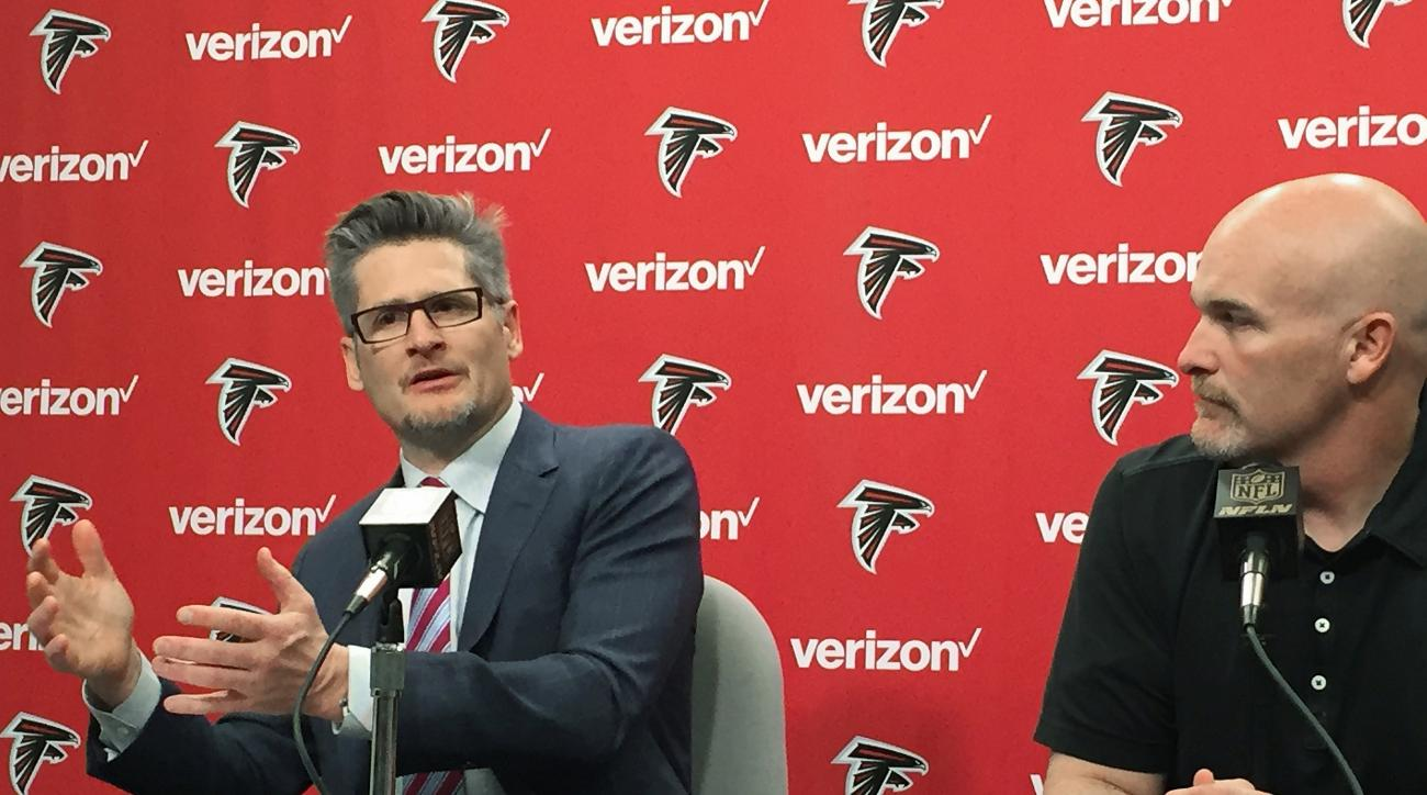 Atlanta Falcons General manager Thomas Dimitroff, left, and Head Coach Dan Quinn speak at a news conference Thursday, Jan 28, 2016, in Flowery Branch, Ga., to discuss the direction of the team after an 8-8 season. (AP Photo/Paul Newberry)