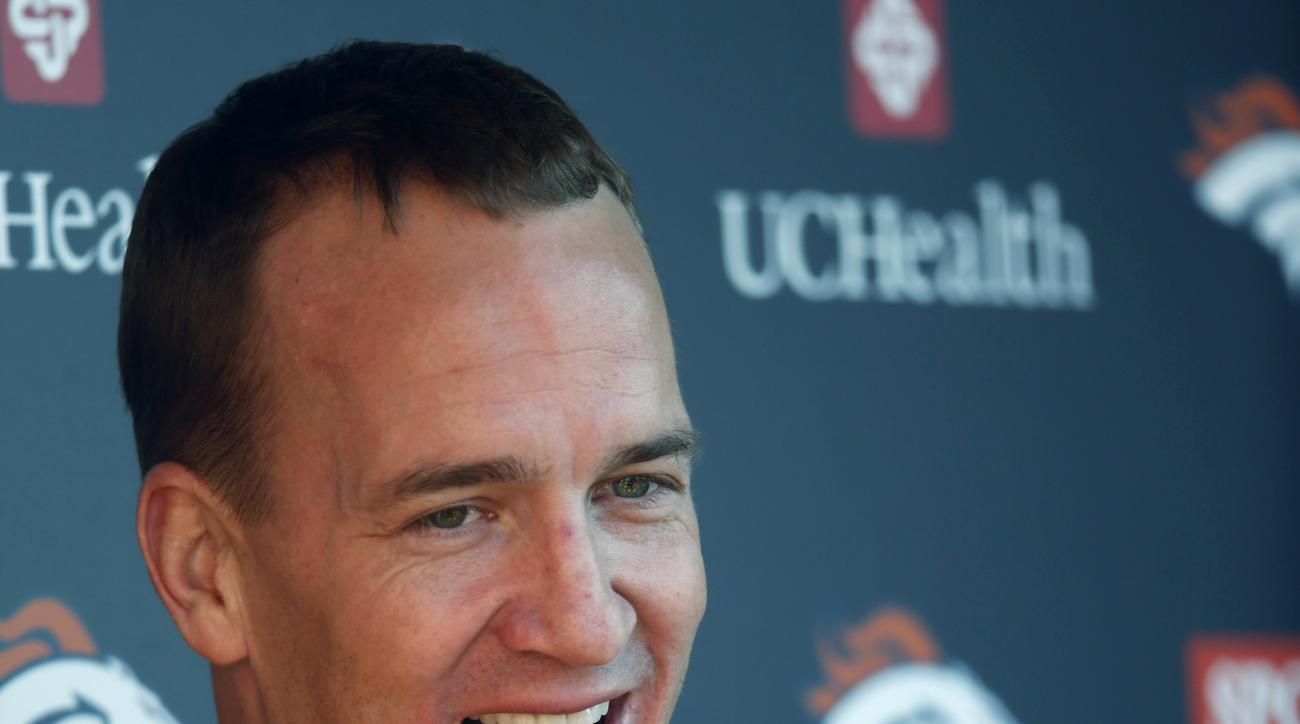 Denver Broncos quarterback Peyton Manning jokes with reporters after an NFL football practice at the team's headquarters, Thursday, Jan. 28, 2016, in Englewood, Colo. The Broncos are preparing to face the Carolina Panthers in Super Bowl 50 on Sunday, Feb.