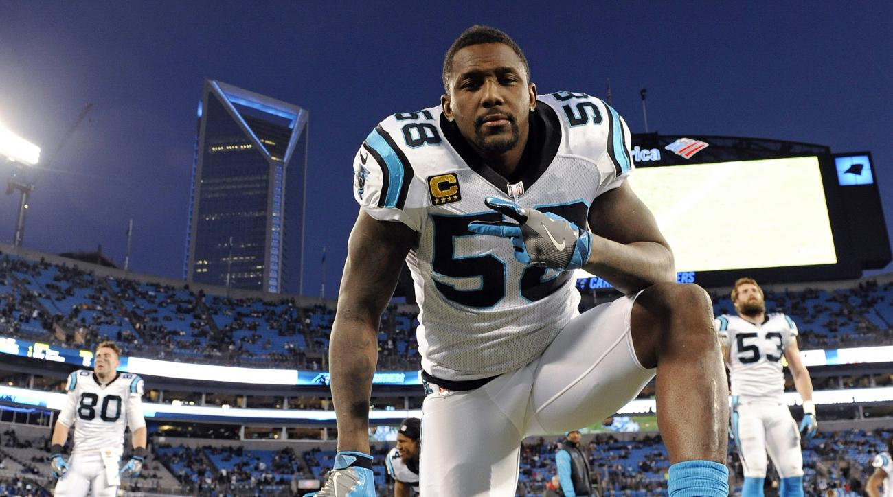 FILE - In this Jan. 24, 2016, file photo, Carolina Panthers' Thomas Davis warms up before the NFL football NFC Championship game against the Arizona Cardinals in Charlotte, N.C. Panthers All-Pro linebacker Davis broke his arm in Sunday's NFC championship