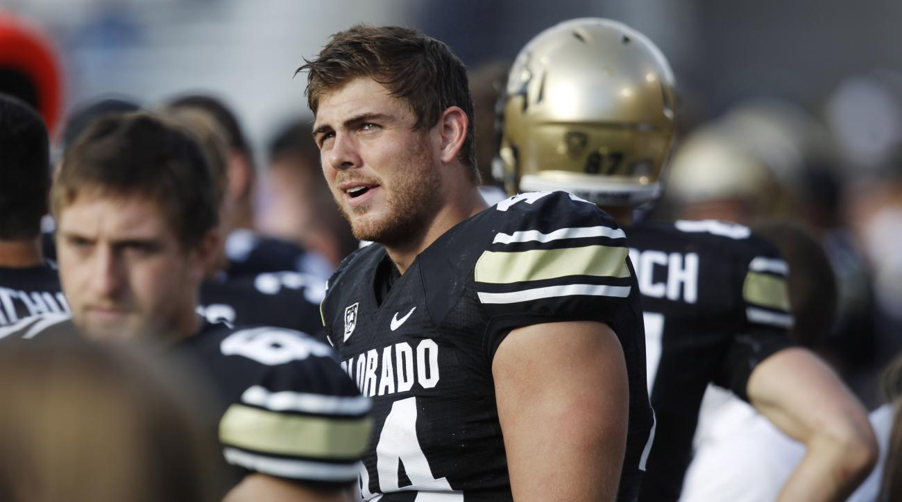 FILE - In this Nov. 17, 2012, file photo, Colorado tight end Nick Kasa watches from the sideline as Colorado trails Washington during an NCAA college football game in Boulder, Colo. Kasa was signed to the Denver Broncos practice squad Monday, Jan. 25, 201