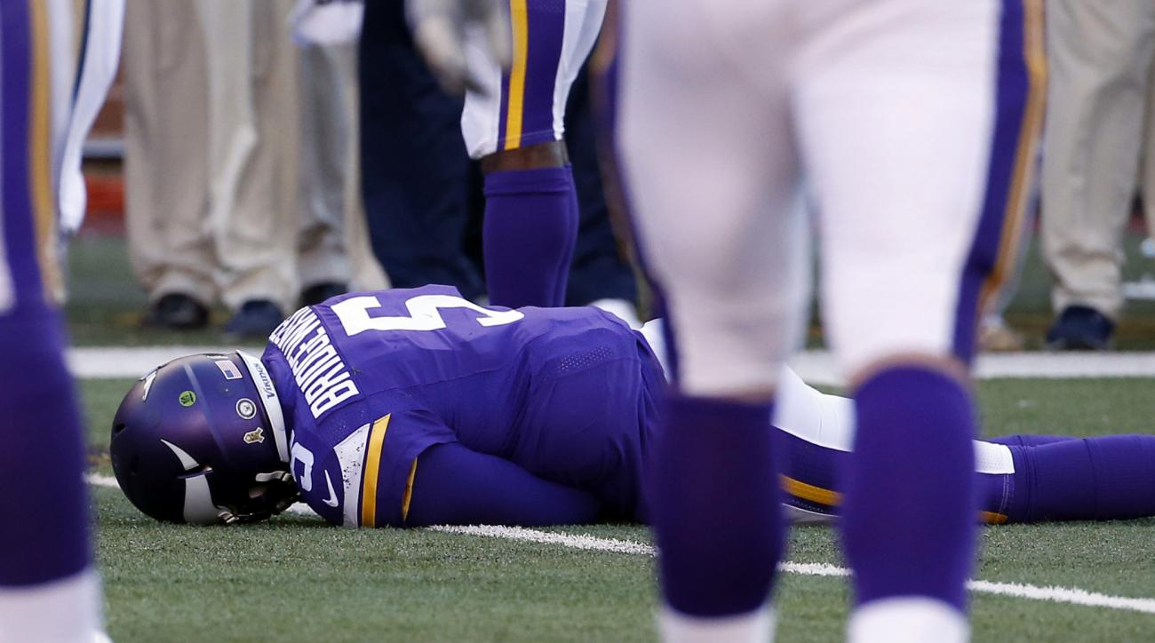 FILE - In this Nov. 8, 2015, file photo, Minnesota Vikings quarterback Teddy Bridgewater lies on the field after a hit during the second half of an NFL football game against the St. Louis Rams, in Minneapolis. Bridgewater sustained a concussion.  (AP Phot
