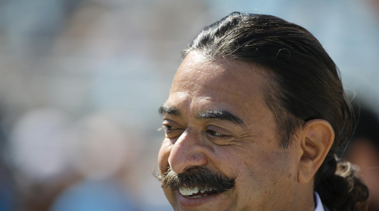 Jacksonville Jaguars team owner Shad Khan watches players warm up before an NFL football game against the Cleveland Browns in Jacksonville, Fla., Sunday, Oct. 19, 2014. (AP Photo/Stephen B. Morton)