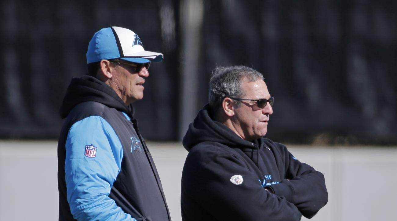 Carolina Panthers head coach Ron Rivera, left, and general manager Dave Gettleman, right, look on during NFL football practice, Friday, Jan. 29, 2016, in Charlotte, N.C. (AP Photo/Chuck Burton)