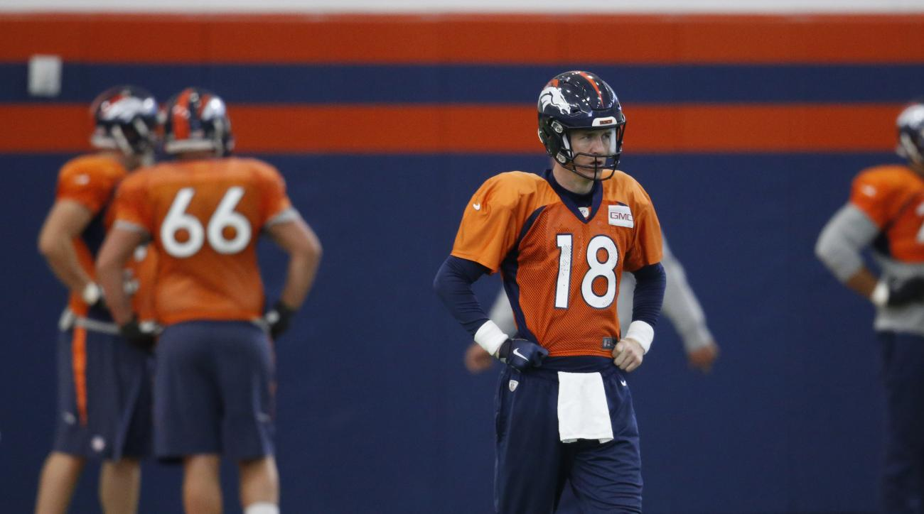 Denver Broncos quarterback Peyton Manning waits to throw during NFL football practice, Friday, Jan. 29, 2016, in Englewood, Colo. The Broncos are preparing to face the Carolina Panthers in Super Bowl 50 on Sunday, Feb. 7, in Santa Clara, Calif. (AP Photo/