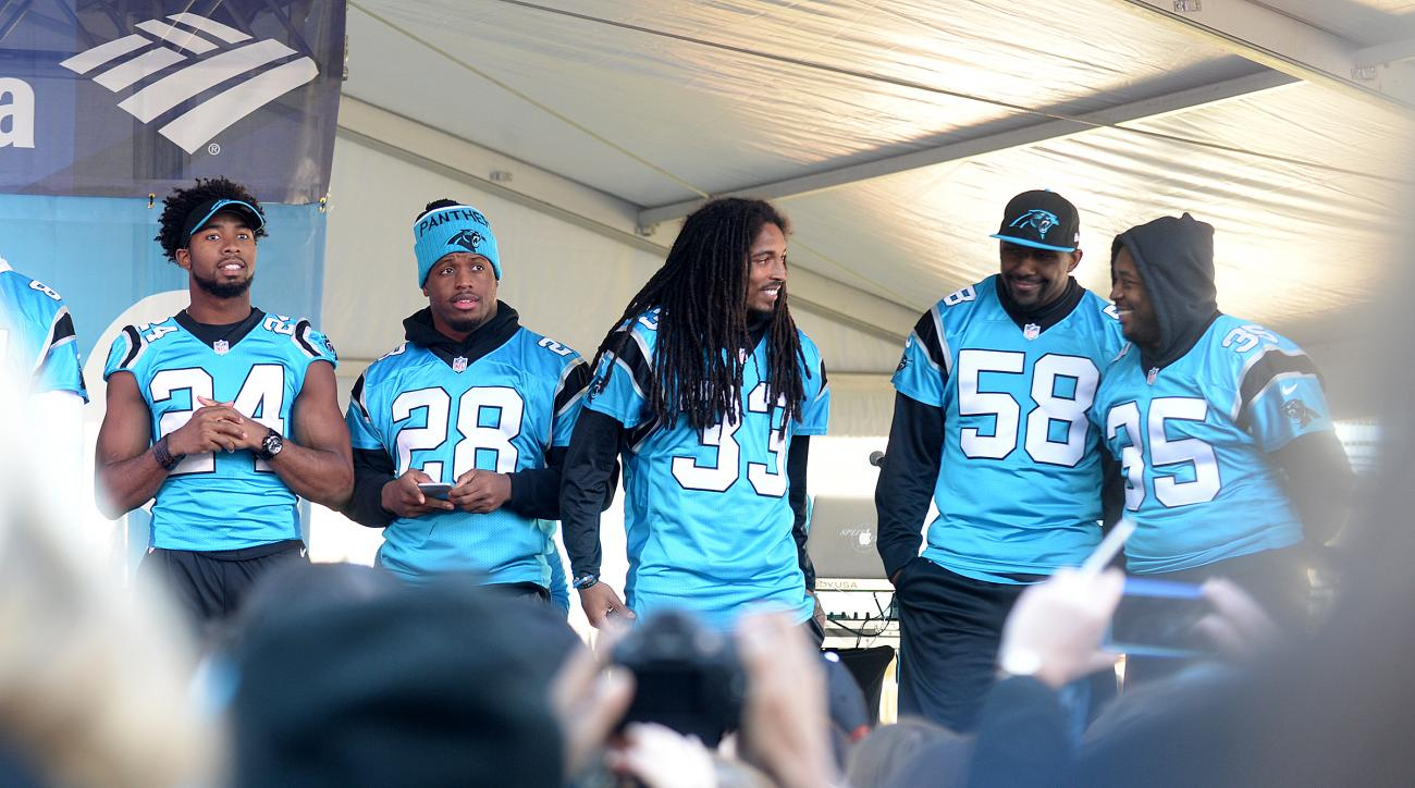 CORRECTS DATE - Carolina Panthers, from left, Josh Norman, Jonathan Stewart, Tre Boston, Thomas Davis, and Mike Tolbert make an appearance on the stage during the Panthers Pride Rally in Romare Bearden Park, Friday, Jan. 29, 2016, in Charlotte, N.C. The P