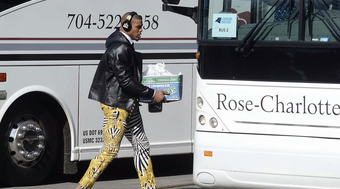 Carolina Panthers quarterback Cam Newton sports zebra-stripe pants as he moves to board a bus on his way to the airport to head to San Francisco for Super Bowl 50 against the Denver Broncos, Sunday, Jan. 31, 2016, in Charlotte, N.C. (Robert Lahser/The Cha