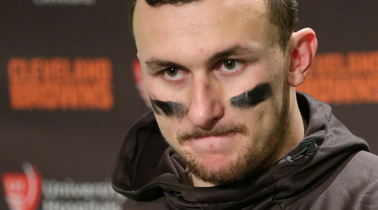 FILE - In this Sunday, Dec. 20, 2015, file photo, Cleveland Browns quarterback Johnny Manziel speaks with media members after an NFL football game against the Seattle Seahawks, in Seattle. Tired of Manziel's off-field transgressions, some Browns fans have