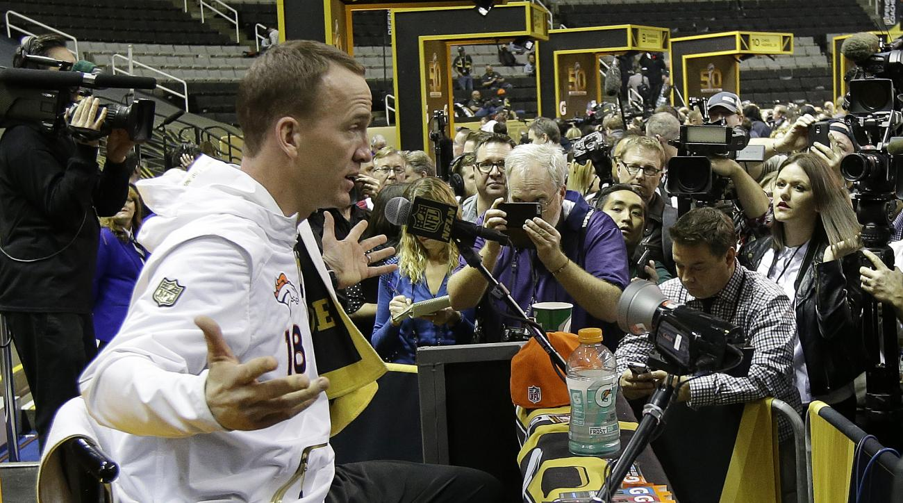 Denver Broncos' Peyton Manning answers a question during Opening Night for the NFL Super Bowl 50 football game Monday, Feb. 1, 2016, in San Jose, Calif. (AP Photo/Jeff Chiu)