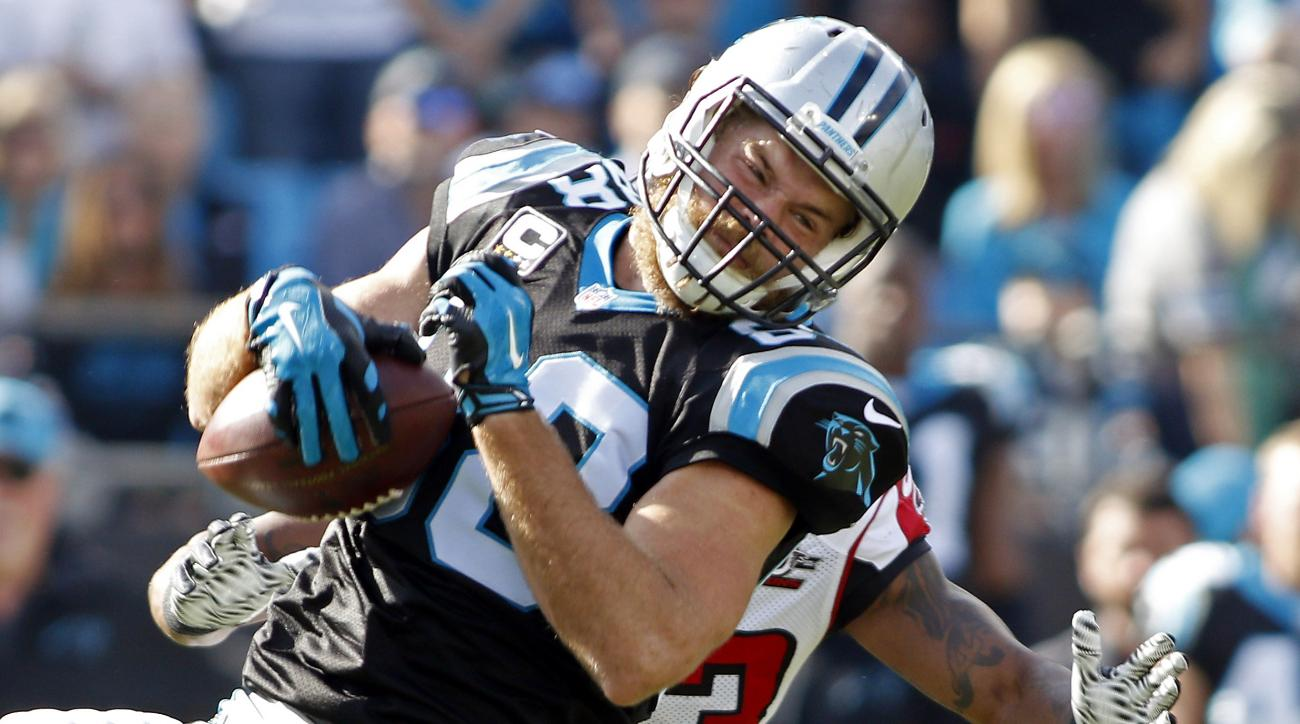 FILE - in this Dec. 13, 2015, file photo, Carolina Panthers' Greg Olsen (88) secures a pass as he moves against Atlanta Falcons' Robert Alford (23) during the first half of an NFL football game in Charlotte, N.C. Peyton Manning and Cam Newton recognize th