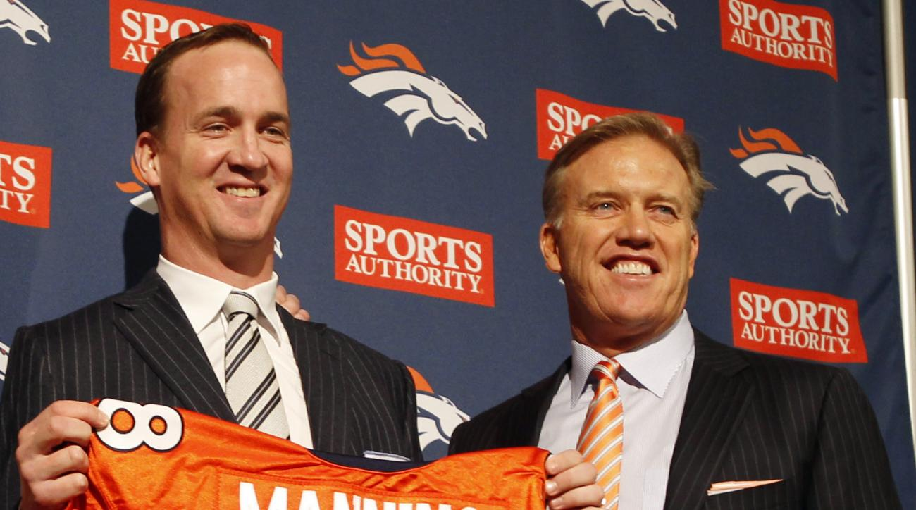FILE - In thisMarch 20, 2012, file photo, Denver Broncos quarterback Peyton Manning and executive vice president of football operations John Elway pose during an NFL football news conference at the team's headquarters in Englewood, Colo. Elway is one of t