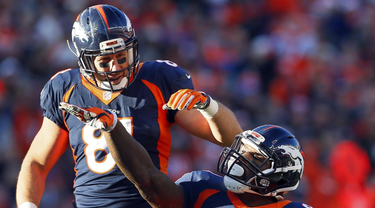 FILE - In this Dec. 13, 2015, file photo, Denver Broncos tight end Vernon Davis (80) signals first down as teammate Owen Daniels (81) looks on during the first half of an NFL football game against the Oakland Raiders in Denver. He may well play a bit part