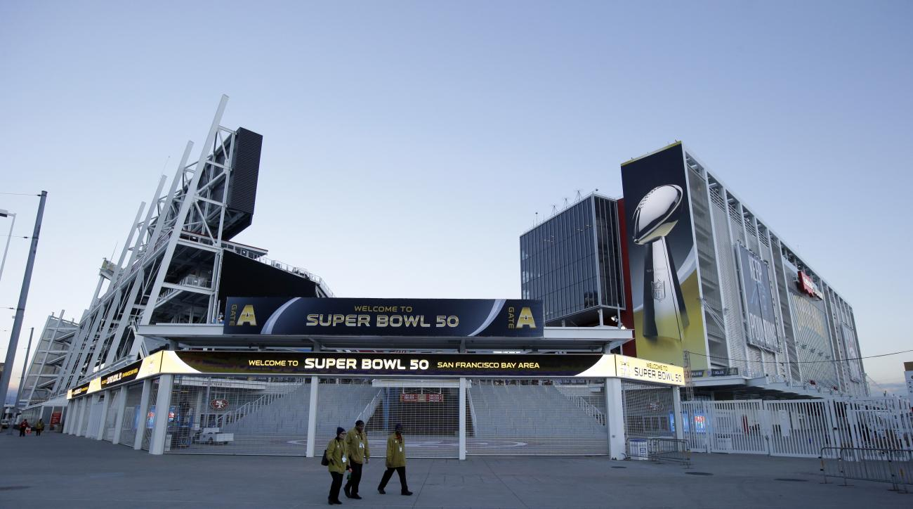 Workers walk outside of Levi's Stadium Tuesday, Feb 2, 2016 in Santa Clara, Calif. The Denver Broncos will play the Carolina Panthers in the NFL Super Bowl 50 football game Sunday, Feb. 7, 2015, at Levi's Stadium. (AP Photo/Marcio Jose Sanchez)