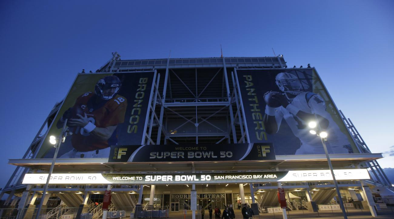 The entrance to Levi's Stadium is decorated with images of Denver Broncos quarterback Peyton Manning, left, and Carolina Panthers quarterback Cam Newton Tuesday, Feb 2, 2016 in Santa Clara, Calif. The Denver Broncos will play the Carolina Panthers in the