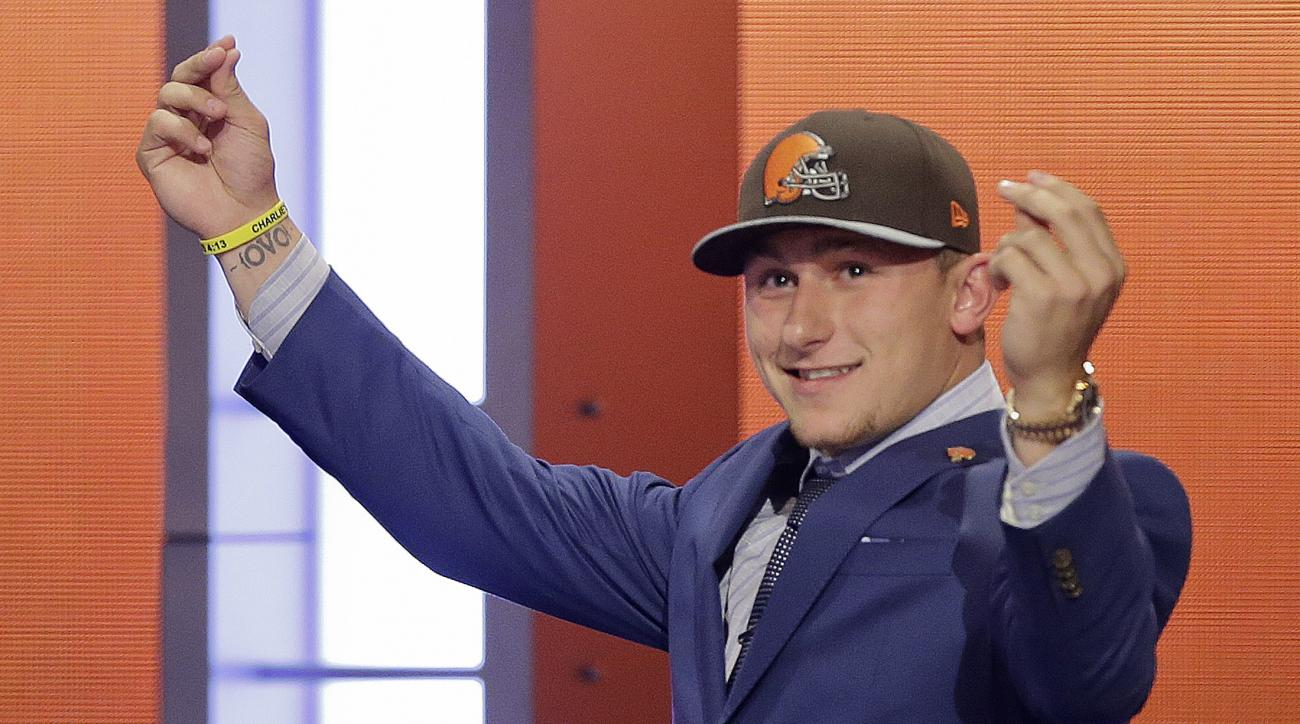 FILE - In this May 8, 2014, file photo, Texas A&M quarterback Johnny Manziel reacts after being selected by the Cleveland Browns as the 22nd pick during the first round of the NFL Draft in New York. The Browns indicated Tuesday, Feb. 2, 2016, that they've