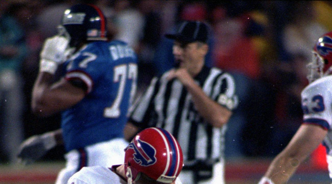 FILE - In this Jan. 27, 1991, file photo, Buffalo Bills kicker Scott Norwood walks off the field after missing what would have been the game-winning field goal in NFL football's Super Bowl XXV against the New York Giants in Tampa, Fla. The Giants won 20-1