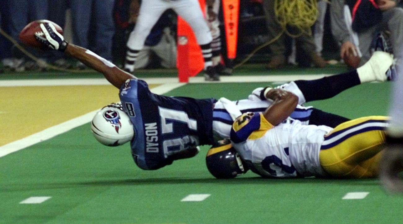 FILE - In this Jan. 30, 2000, file photo, Tennessee Titans wide receiver Kevin Dyson (87) tries but fails to get the ball into the end zone as he is tackled by St. Louis Rams' Mike Jones on the final play of NFL football's Super Bowl XXXIV in Atlanta. The