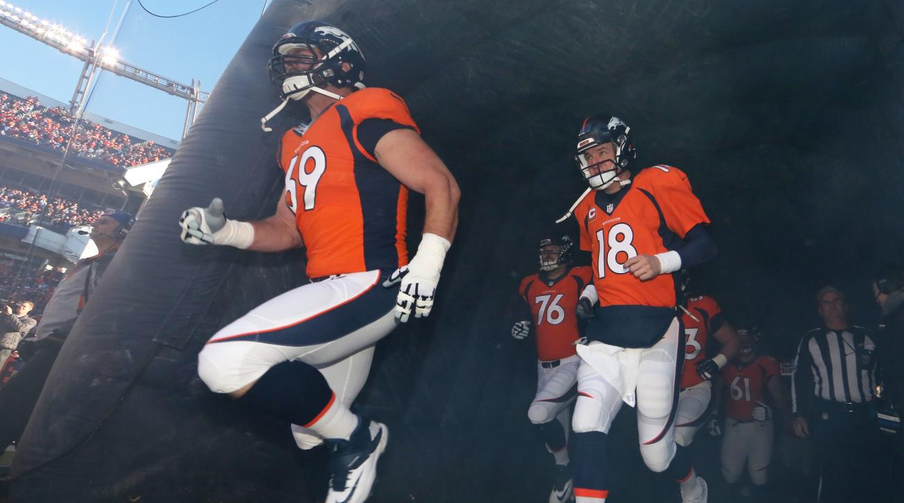 FILE - In this Jan. 3, 2016, file photo, Denver Broncos quarterback Peyton Manning (18) and lineman Evan Mathis (69) take the field for an NFL football game against the San Diego Chargers in Denver. Mathis got released by the Philadelphia Eagles because C