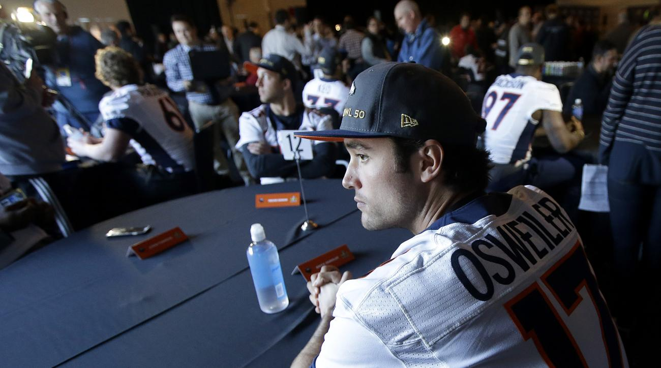Denver Broncos quarterback Brock Osweiler sits at a table between speaking to reporters in Santa Clara, Calif., Wednesday, Feb. 3, 2016. The Denver Broncos will play the Carolina Panthers in Super Bowl 50 Sunday, Feb. 7, 2016. (AP Photo/Jeff Chiu)