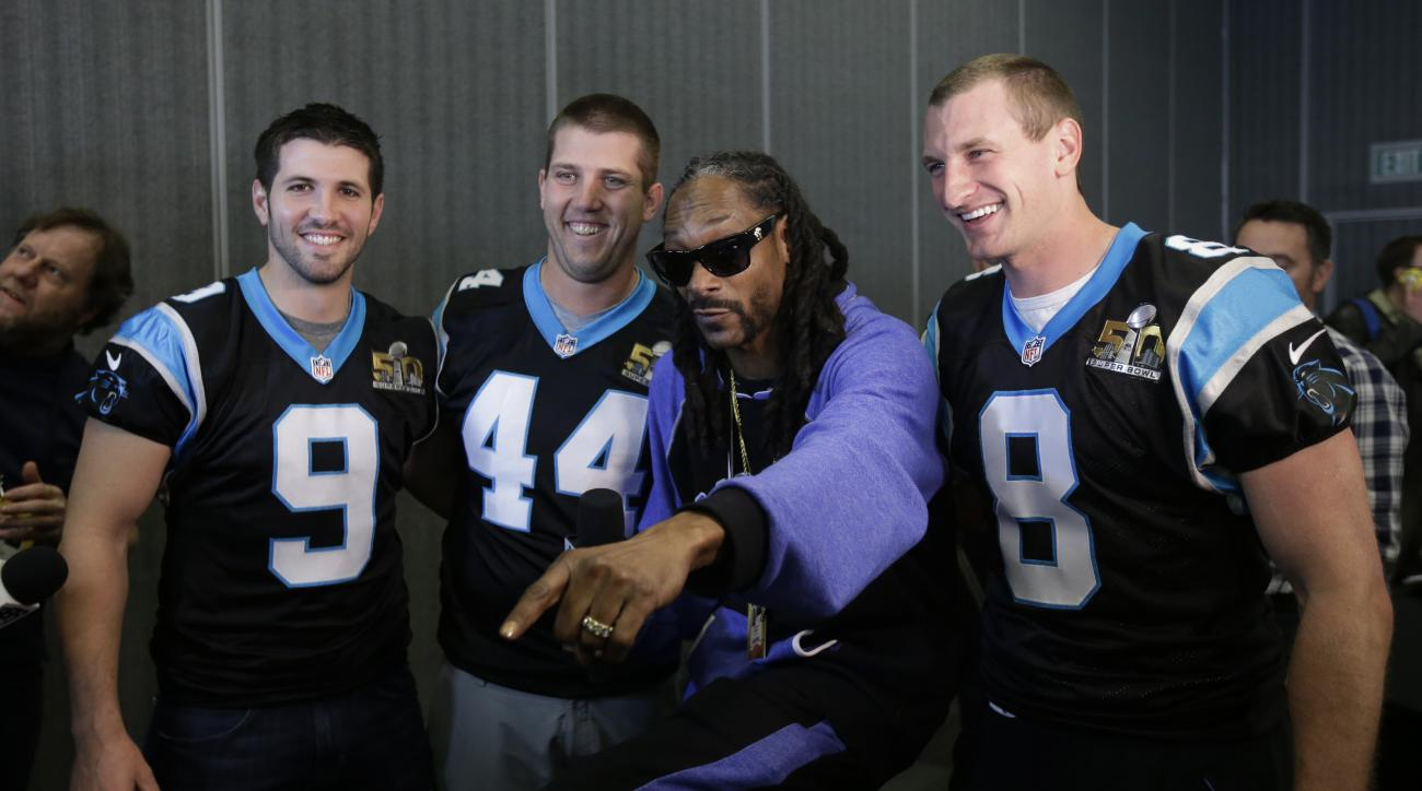 Recording artist Snoop Dogg, second from right, poses for pictures with Carolina Panthers' Graham Gano (9), J.J. Jansen (44) and Brad Nortman (8)  during a press conference in preparation for the Super Bowl 50 football game Thursday Feb. 4, 2016 in San Jo