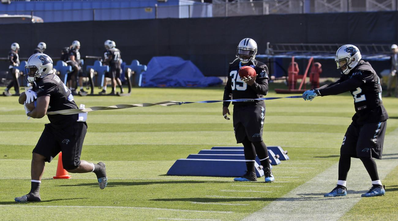 Carolina Panthers running back Cameron Artis-Payne, left, Mike Tolbert (35) and Brandon Wegher, left, participate in drills during a practice in preparation for the Super Bowl 50 football game Thursday Feb. 4, 2016 in San Jose, Calif. (AP Photo/Marcio Jos