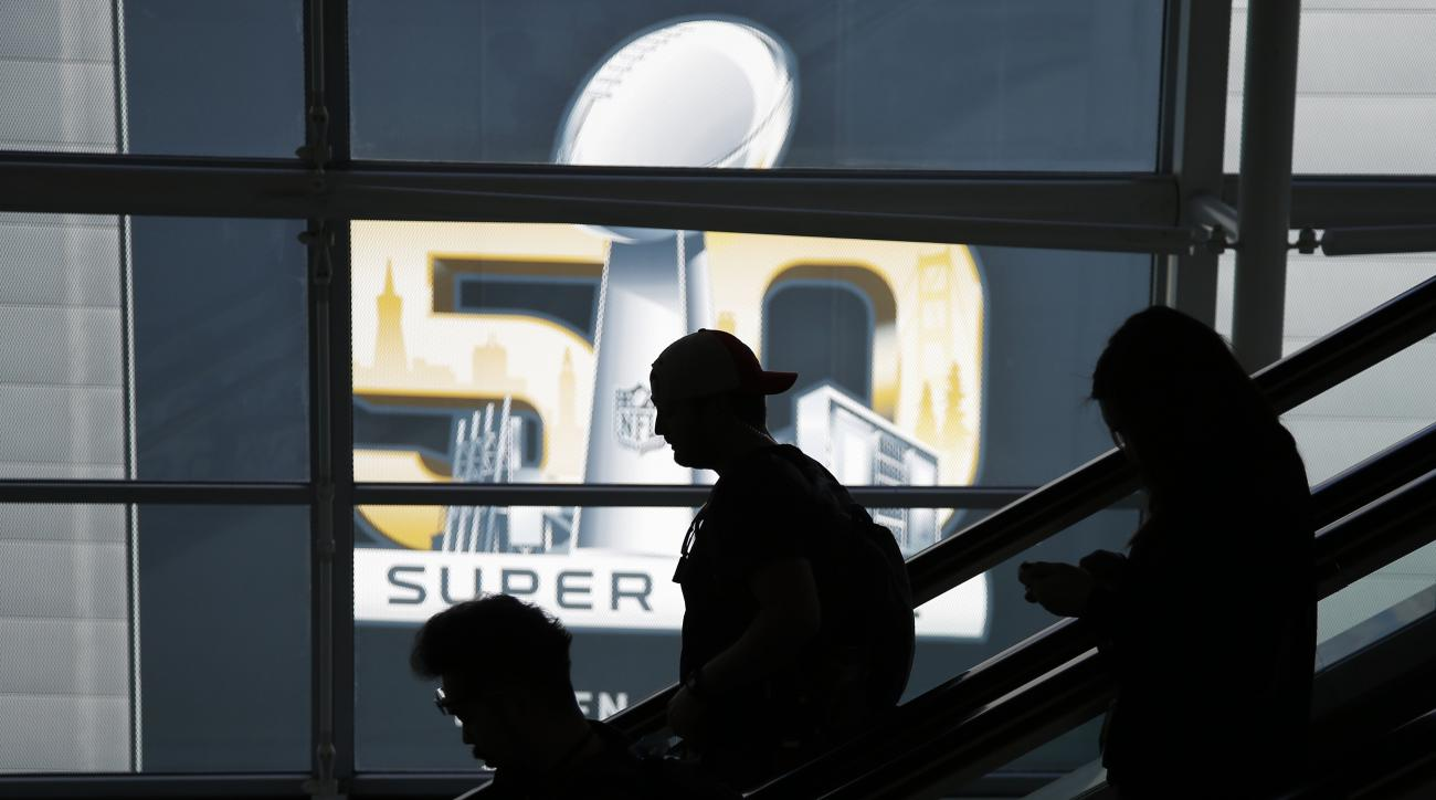 People ride an escalator at the Media Center for the upcoming NFL Super Bowl 50 football game Thursday, Feb. 4, 2016, in San Francisco. (AP Photo/Matt Slocum)