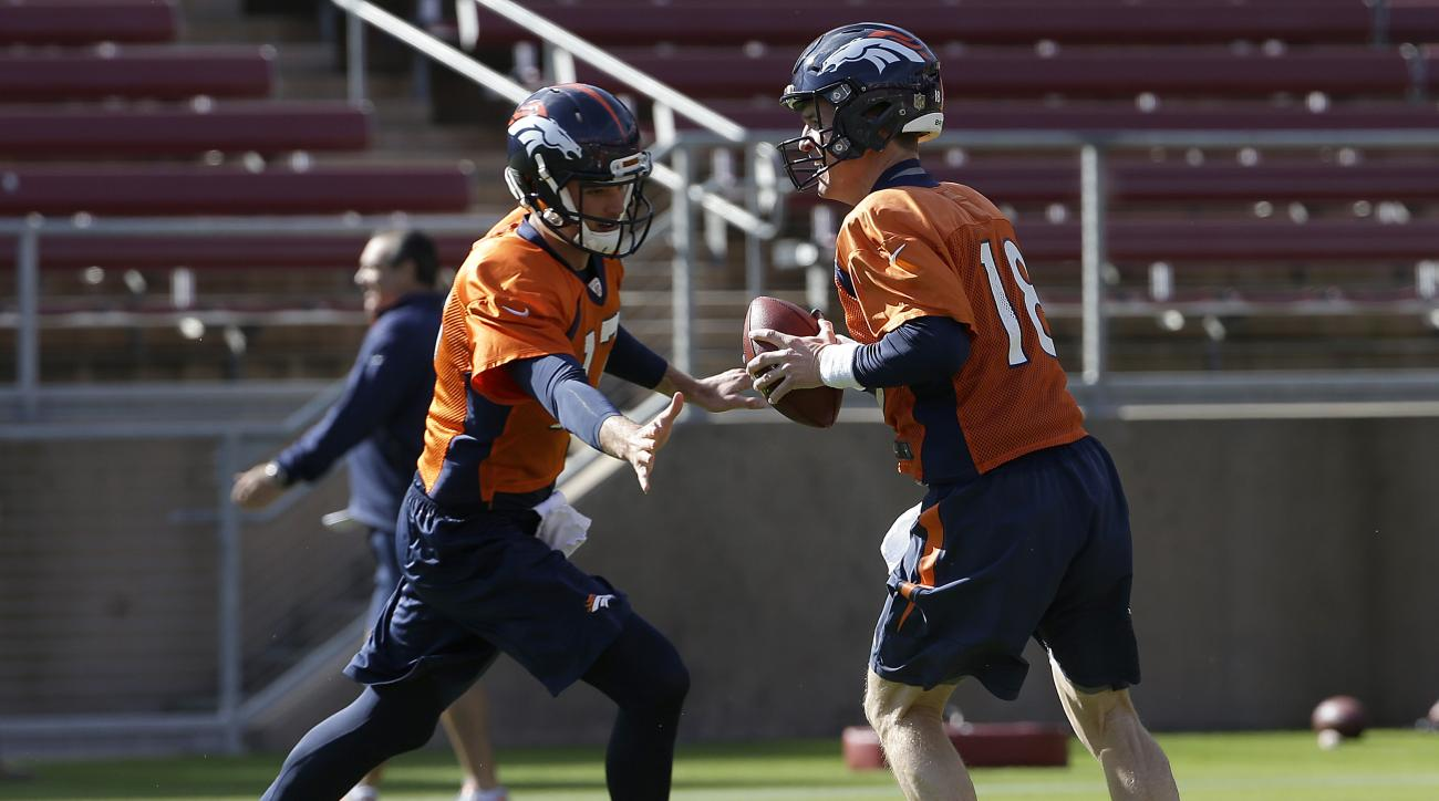 Denver Broncos quarterback Peyton Manning (18) and quarterback Brock Osweiler run a drill during an NFL football practice in Stanford, Calif., Thursday, Feb. 4, 2016. (AP Photo/Jeff Chiu)
