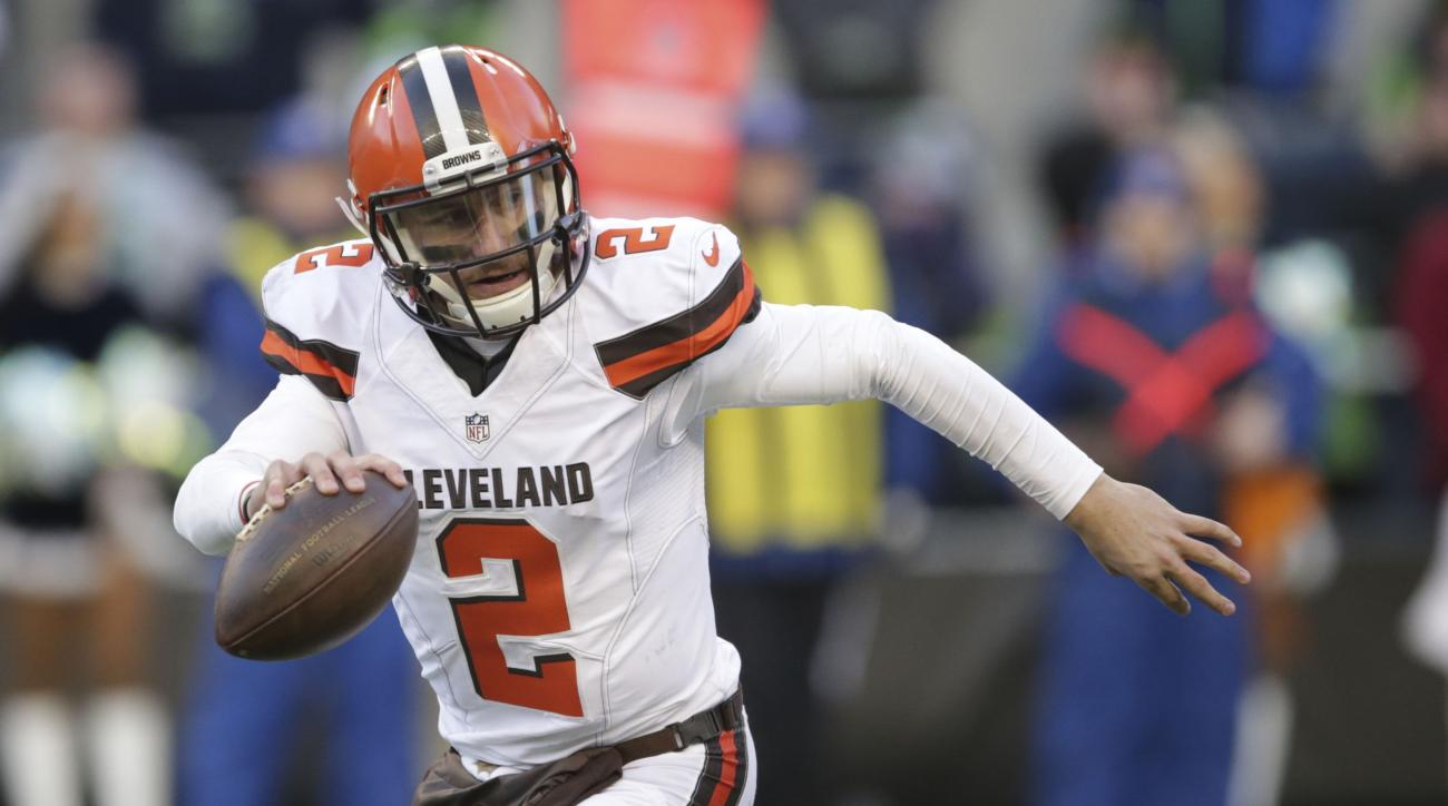 FILE - In this Sunday, Dec. 20, 2015 file photo, Cleveland Browns quarterback Johnny Manziel looks to pass against the Seattle Seahawks in the second half of an NFL football game in Seattle. Johnny Manziel's ex-girlfriend told police the Cleveland Browns