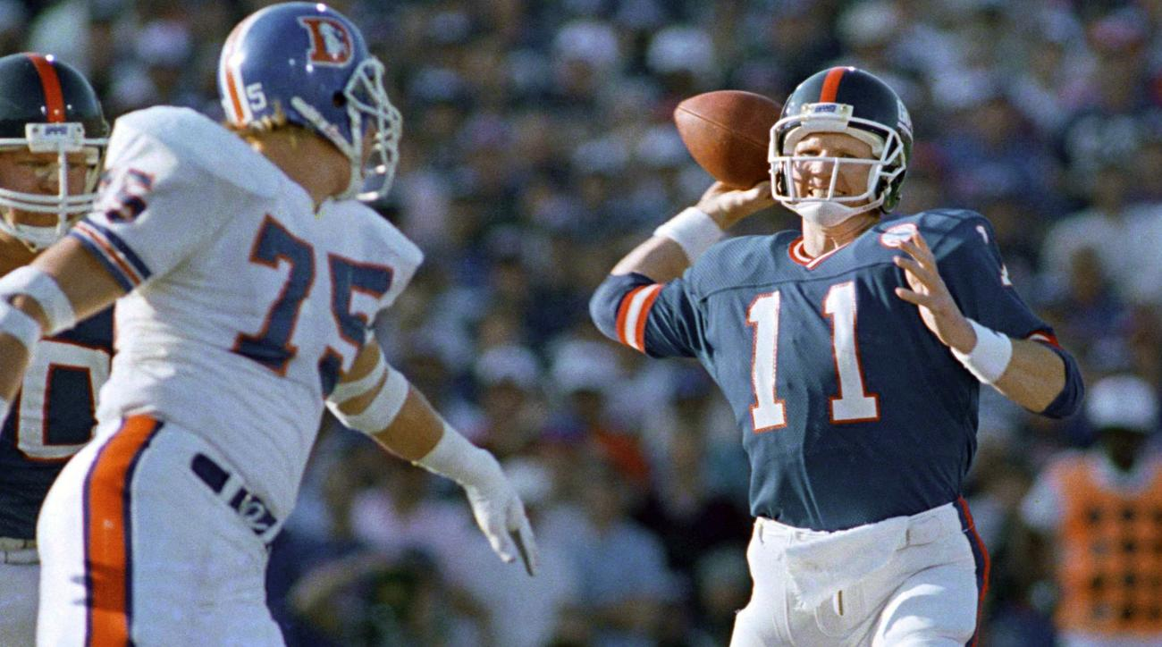 FILE - In this Jan. 25, 1987, file photo, New York Giants quarterback Phil Simms throws a pass in the first quarter of Super Bowl XXI against the Denver Broncos in Pasadena, Calif. Simms was about as close to perfect as a QB can be, going 22 of 25 for 268