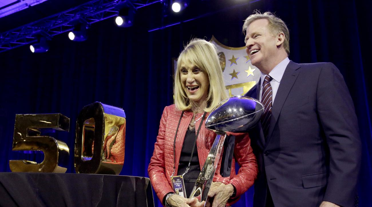 NFL Commissioner Roger Goodell poses with Norma Hunt, the widow of longtime Kansas City Chiefs owner Lamar Hunt, after a news conference Friday, Feb. 5, 2016, in San Francisco. (AP Photo/Charlie Riedel)