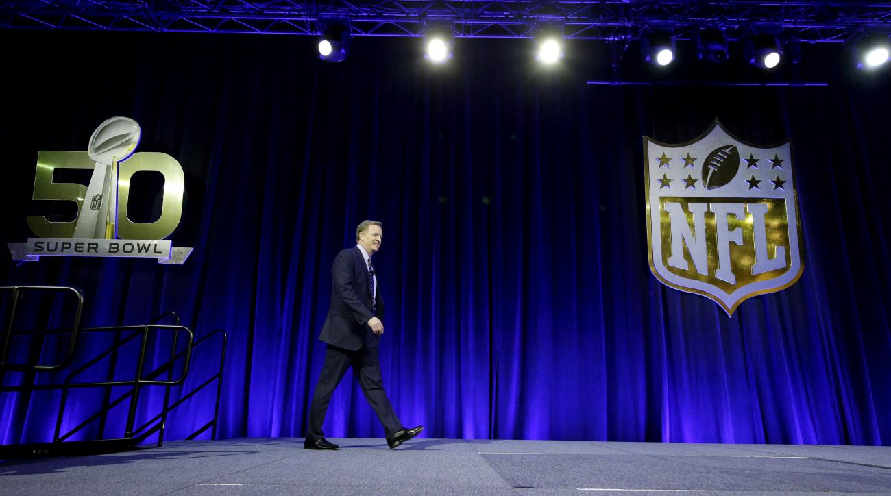 NFL Commissioner Roger Goodell walks onto the stage for a news conference Friday, Feb. 5, 2016, in San Francisco. (AP Photo/Charlie Riedel)