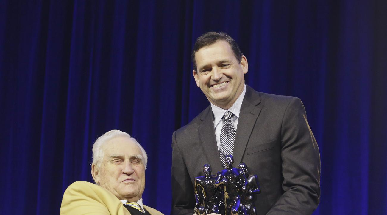 Don Shula, left, presents Tuscarora High School coach Michael Burnett with the Don Shula high school coach of the year award during a press conference a news conference Friday, Feb. 5, 2016, in San Francisco. (AP Photo/Charlie Riedel)