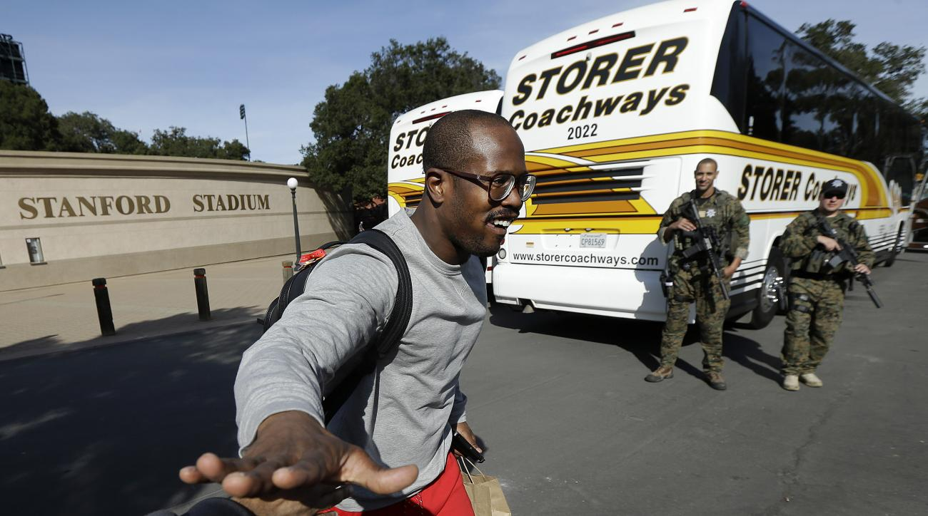 Denver Broncos linebacker Von Miller greets fans before boarding a team bus after an NFL football practice in Stanford, Calif., Friday, Feb. 5, 2016. (AP Photo/Jeff Chiu)