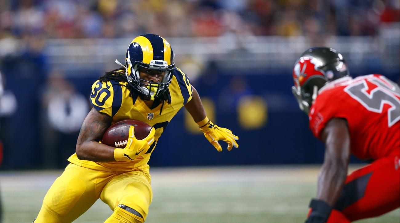 St. Louis Rams running back Todd Gurley, left, runs with the ball as Tampa Bay Buccaneers outside linebacker Lavonte David defends during the second quarter of an NFL football game on Thursday, Dec. 17, 2015, in St. Louis. (AP Photo/Billy Hurst)