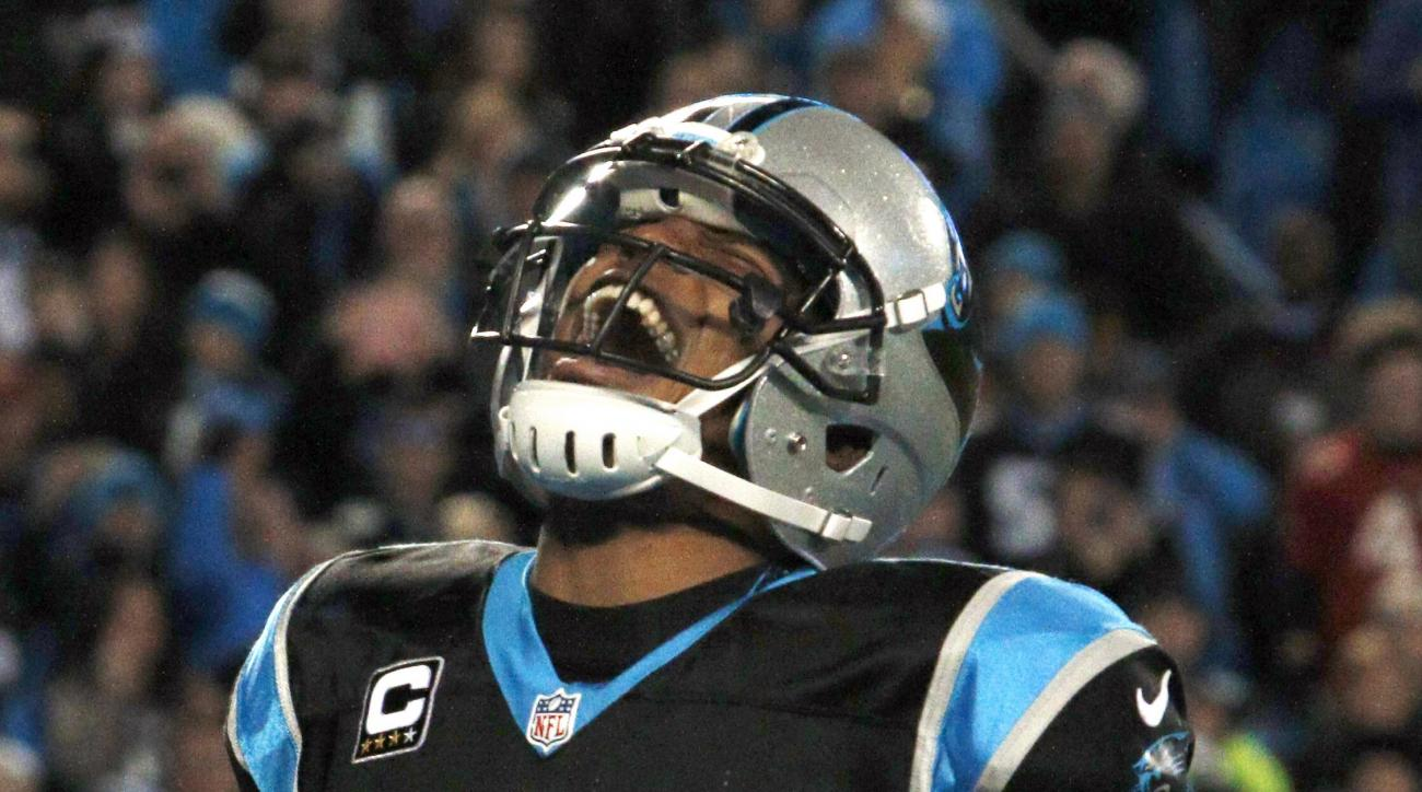 FILE - In this Jan. 3, 2016, file photo, Carolina Panthers quarterback Cam Newton celebrates his touchdown run against the Tampa Bay Buccaneers in the second half of an NFL football game in Charlotte, N.C. Newton has won The Associated Press NFL Most Valu
