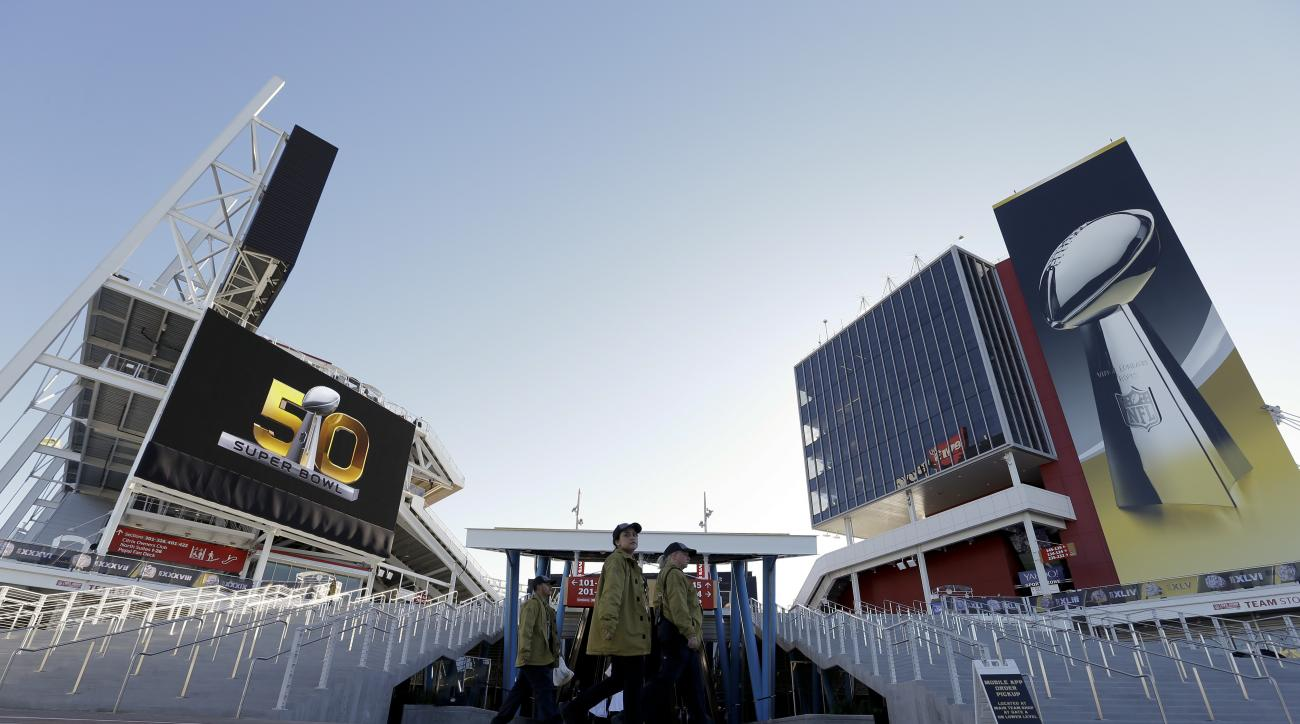 Workers arrive at Levi's Stadium before the NFL Super Bowl 50 football game between the Denver Broncos and the Carolina Panthers,Sunday, Feb. 7, 2016, in Santa Clara, Calif. (AP Photo/David J. Phillip)